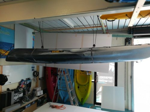 Kayak hoisted to ceiling