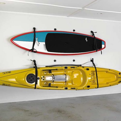 Two kayaks slung on wall using the sling