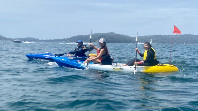 Paddlers crossing Pittwater on the way to Mackerel Beach
