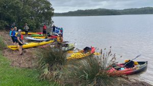 Kayakers on shore at Kincumber for a rest stop