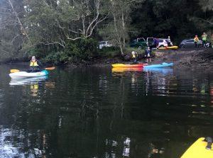 Kayakers pushing off into Mooney Mooney Creek