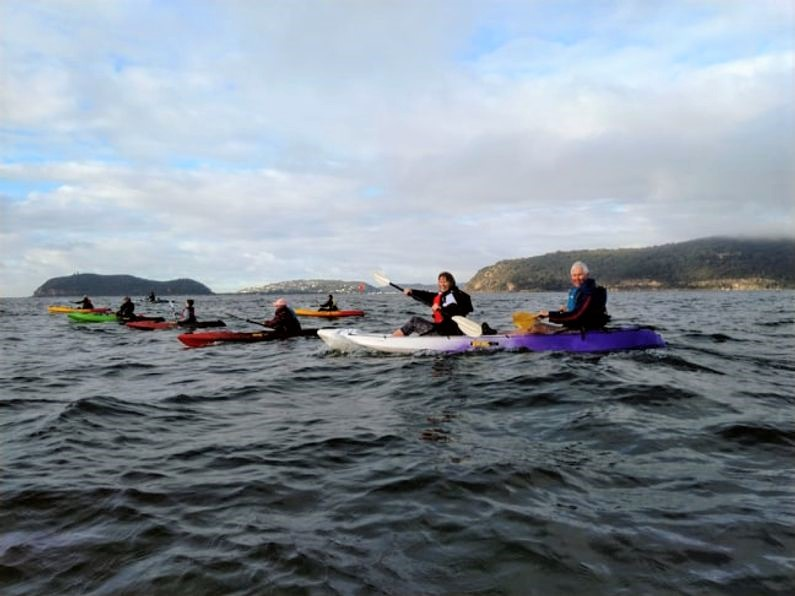 Kayak paddlers in the middle of the Hawkesbury River