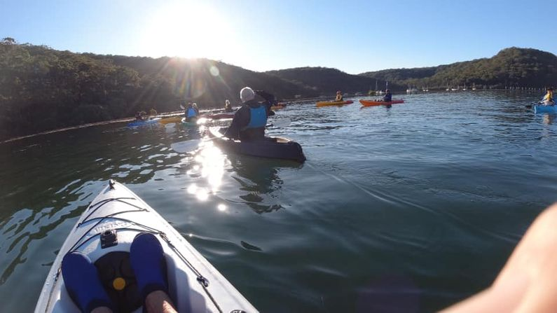 Paddlers moving towards the early morning light
