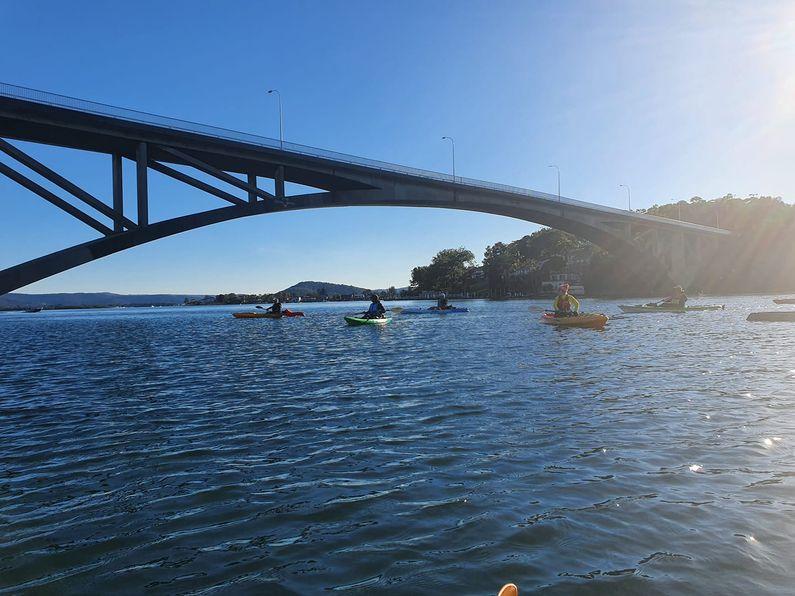 Paddlers moving under the Rip Bridge
